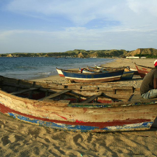 """fisherman sits on a boat near the village of Baia Farta in Angola. 04-20-2007"" stock image"