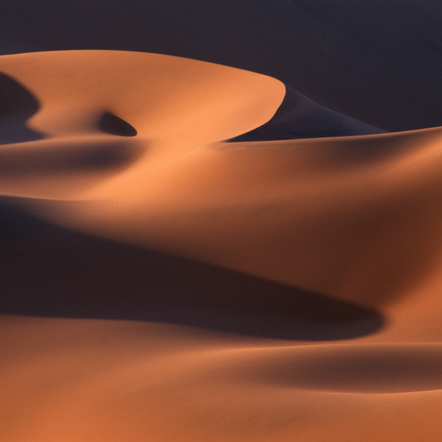 """abstract image of sand dunes near Sossusvlei at sunrise in Namib Desert,..."" stock image"