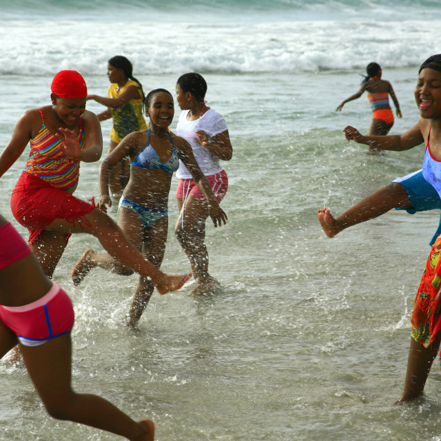"""schoolchildren enjoy their first time ever at the ocean, Camps Bay beach,..."" stock image"