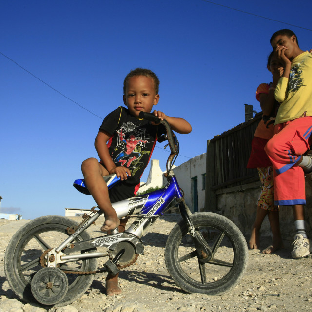 """""""small boy on bicycle, Waenhuiskrans village in Arniston, Western Cape, South..."""" stock image"""