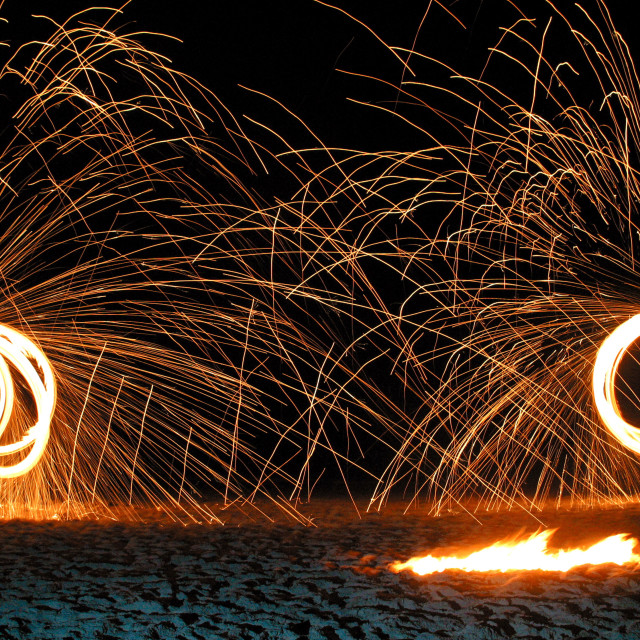 """fire juggling and fire dancing on Clifton Beach, Cape Town, South Africa...."" stock image"