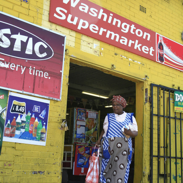 """""""A woman walks out of a shop in Langa township in Cape Town, South Africa...."""" stock image"""