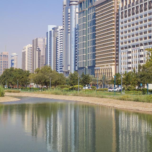 """City Center buildings reflecting in Corniche Lake, Abu Dhabi, United Arab..."" stock image"