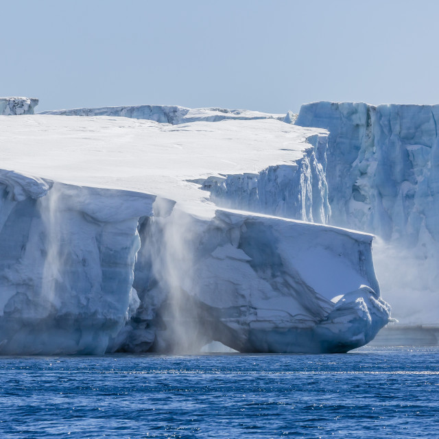 """""""Katabatic winds blow snow into the sea off glacier face at Brown Bluff,..."""" stock image"""
