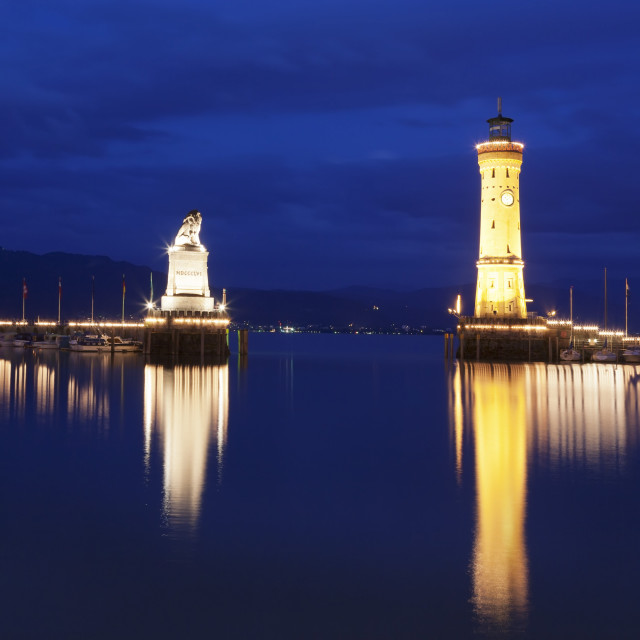 """""""Port with lighthouse and sculpture of the Bavarian Lion, Lake Constance..."""" stock image"""