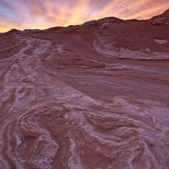 """""""Brilliant orange clouds at sunset over red and white sandstone, White Pocket,..."""" stock image"""