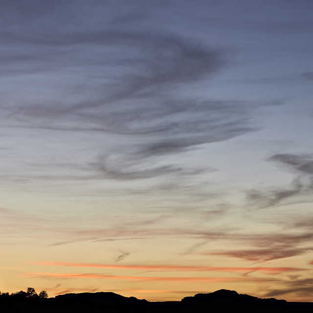 """""""Wispy clouds at sunset, White Pocket, Vermilion Cliffs National Monument,..."""" stock image"""