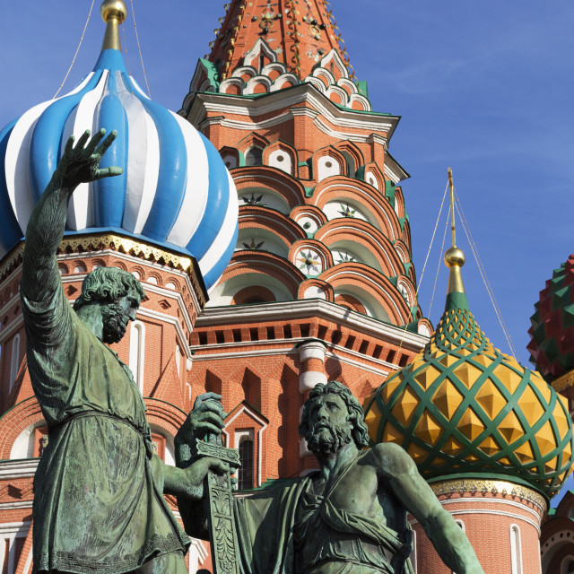 """""""Statue of Minin and Pozharskiy and the onion domes of St. Basil's Cathedral..."""" stock image"""