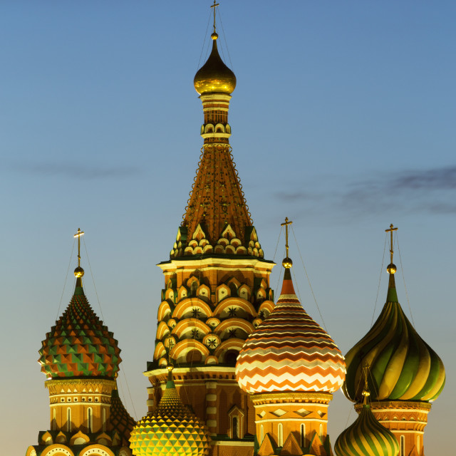 """The onion domes of St. Basil's Cathedral in Red Square illuminated at night,..."" stock image"