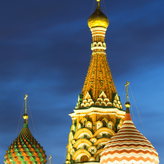 """""""The onion domes of St. Basil's Cathedral in Red Square illuminated at night,..."""" stock image"""