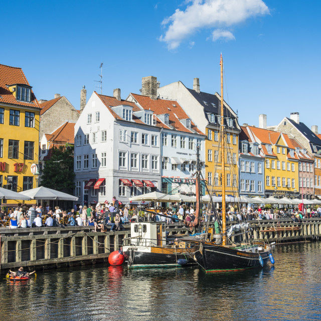 """Fishing boats in Nyhavn, 17th century waterfront, Copernhagen, Denmark,..."" stock image"