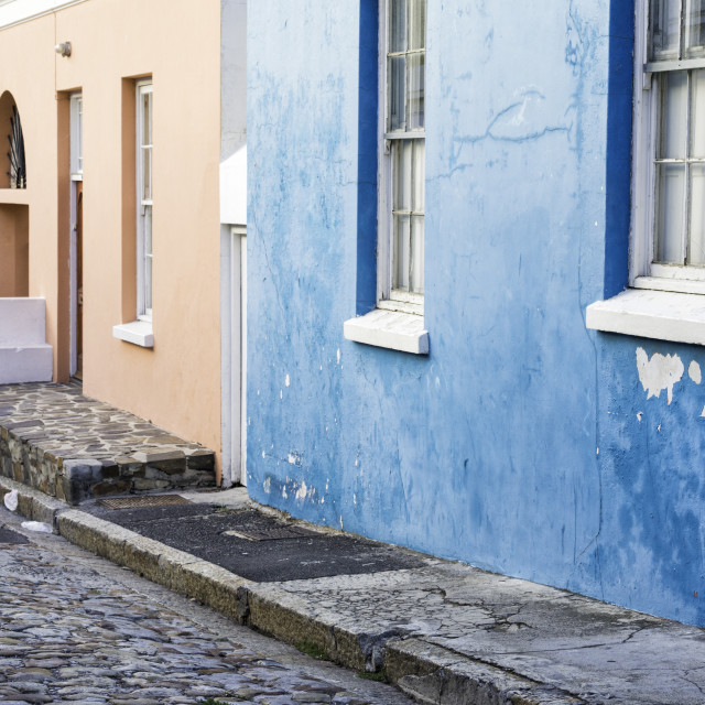 """""""Pastel colored homes on cobblestone street in Bo-Kaap residential district,..."""" stock image"""