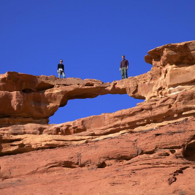 """""""Tourists climbing at Wadi Rum, Jordan, Middle East"""" stock image"""