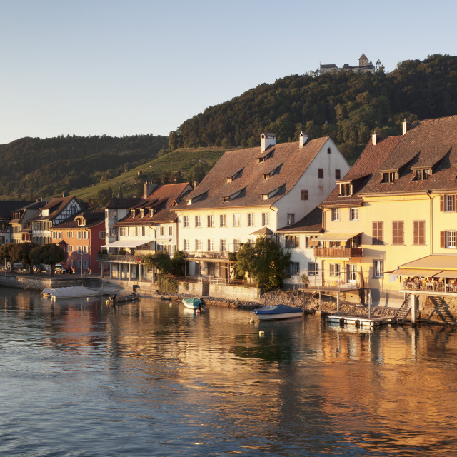 """Old town along the Rhine promenade with Burg Hohenklingen castle at sunset,..."" stock image"