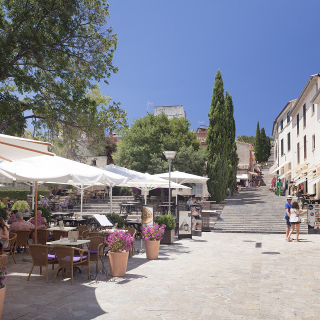 """Street cafes and restaurant at market place Placa Major, Pollenca, Majorca,..."" stock image"