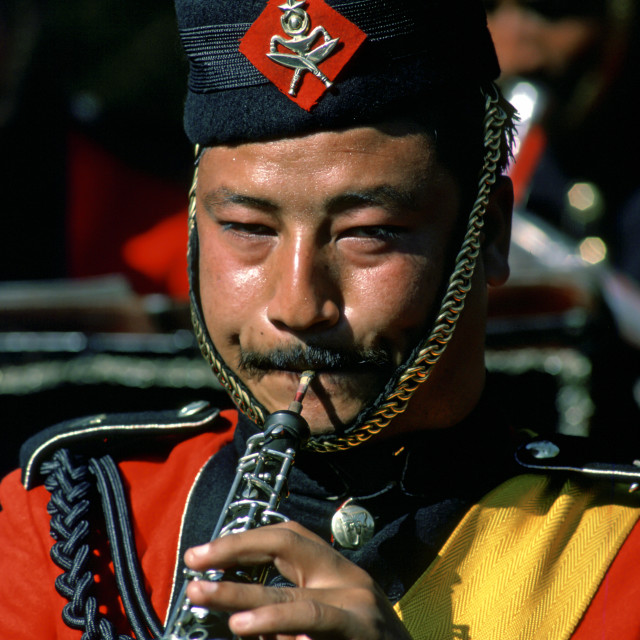 """""""Man plays clarinet in Nepalese Army Band, Nepal"""" stock image"""