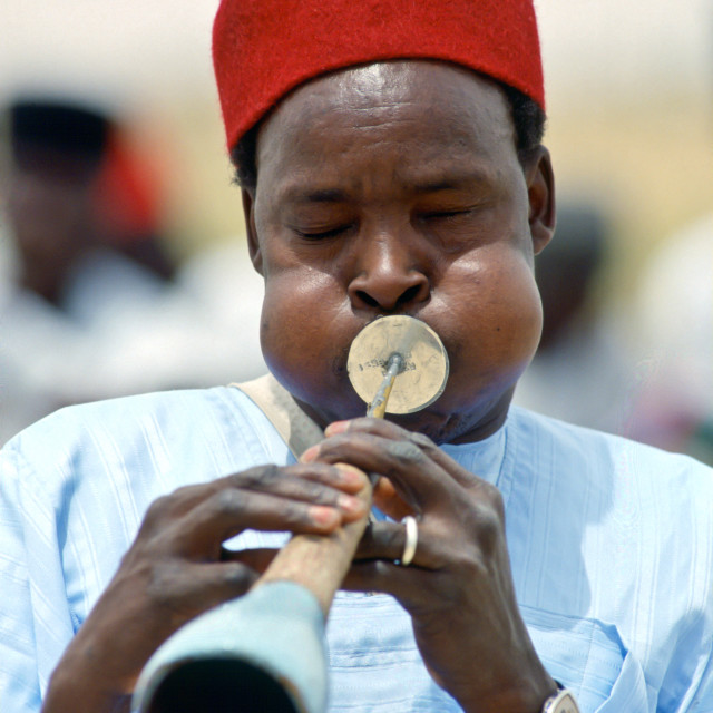 """Musician playinga traditional wind instrument, Nigeria"" stock image"