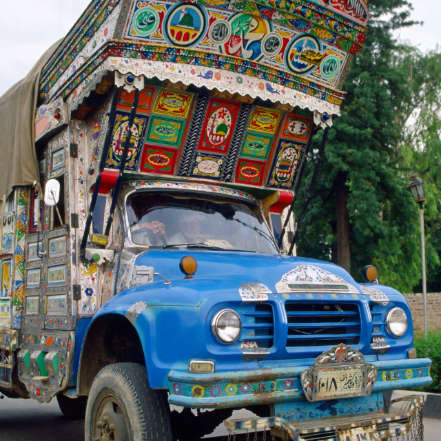 """A lorry decorated with paintings and symbols in Islamabad, Pakistan"" stock image"