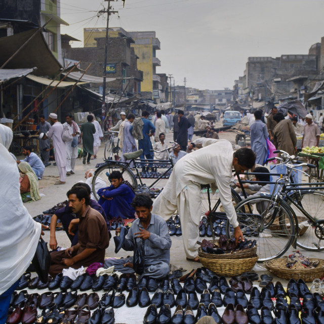 """""""Shoes on sale at a street market, Islamabad, Pakistan."""" stock image"""