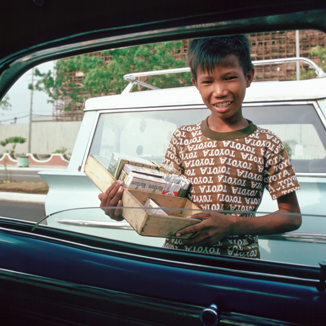 """""""Boy sells cigarettes at car windows in Manila, Philippines"""" stock image"""