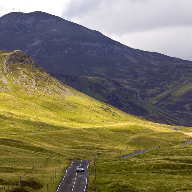 """Car drives through the Glen Clunie hills and Grampian Mountains, Scotland,..."" stock image"