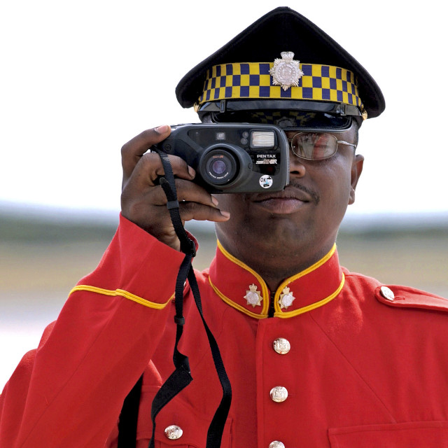 """""""Soldier from the Jamaica Defence Force taking a photograph during parade"""" stock image"""