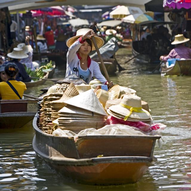 """Hat seller in the Damnern Saduak floating market, Bankok, Thailand"" stock image"
