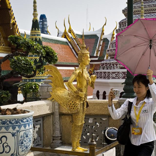 """Tourist visits the Grand Palace Complex, Bangkok, Thailand"" stock image"