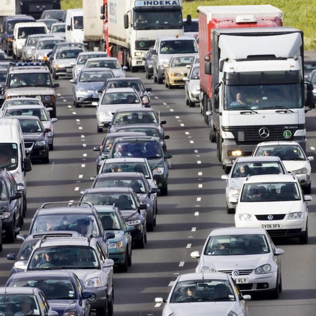 """Traffic congestion cars and trucks on M25 motorway, London, United Kingdom"" stock image"