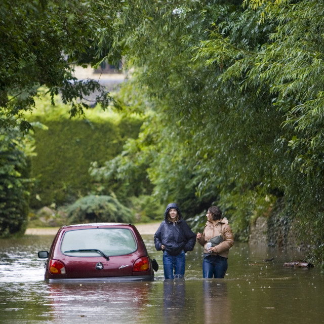 """Car abandoned in flood in Ascott-Under-Wychwood, The Cotswolds, Oxfordshire,..."" stock image"