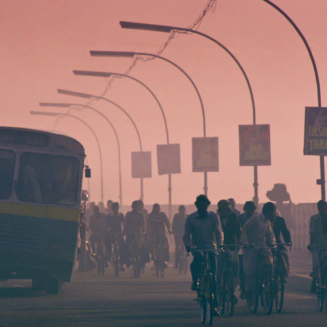 """""""Early morning rush hour in the streets of Delhi, India. Commuters on..."""" stock image"""