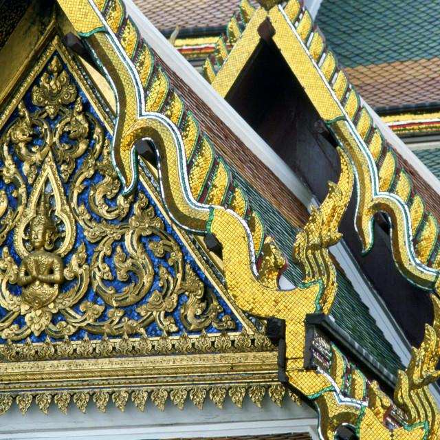 """""""Detail of the ornate gilded woodcarving and roof tiling on the Grand Palace..."""" stock image"""