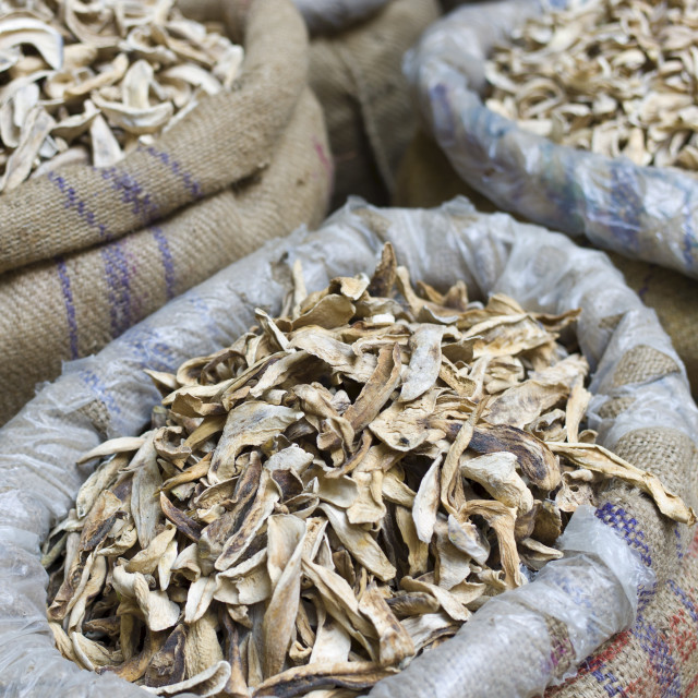 """Dried mango skins on sale at Khari Baoli spice and dried foods market, Old..."" stock image"