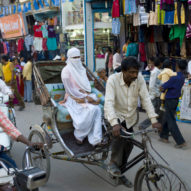 """Street scene in holy city of Varanasi, young muslim woman in white burkha..."" stock image"