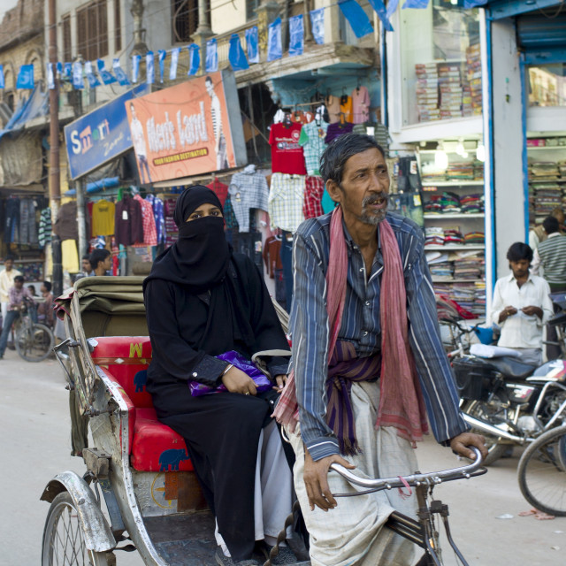 """Street scene in holy city of Varanasi, young muslim woman in black burkha..."" stock image"