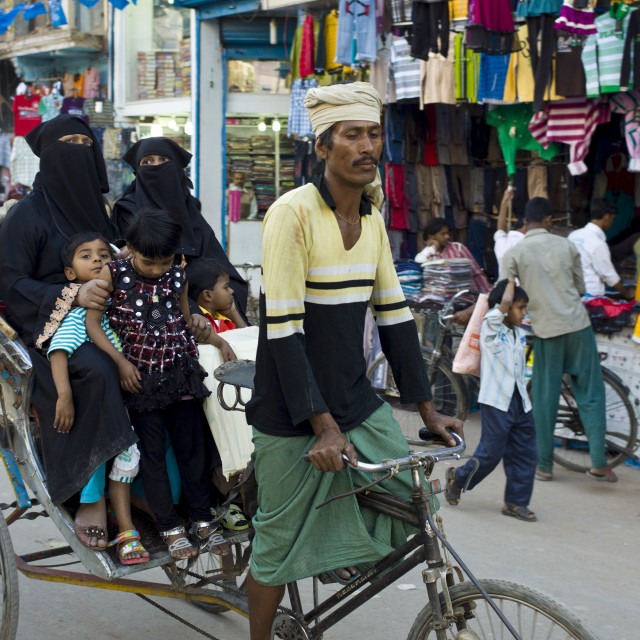 """Street scene in holy city of Varanasi, young muslim women in black burkhas..."" stock image"