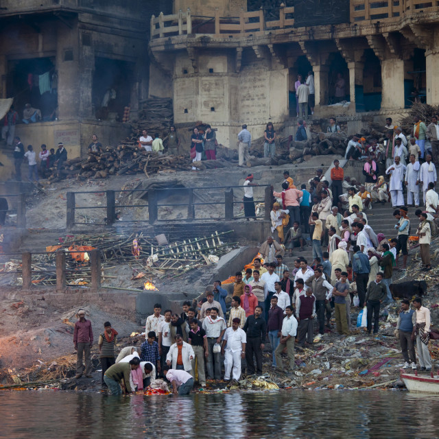 """Body bathed in River Ganges and traditional Hindu cremation on funeral pyre..."" stock image"