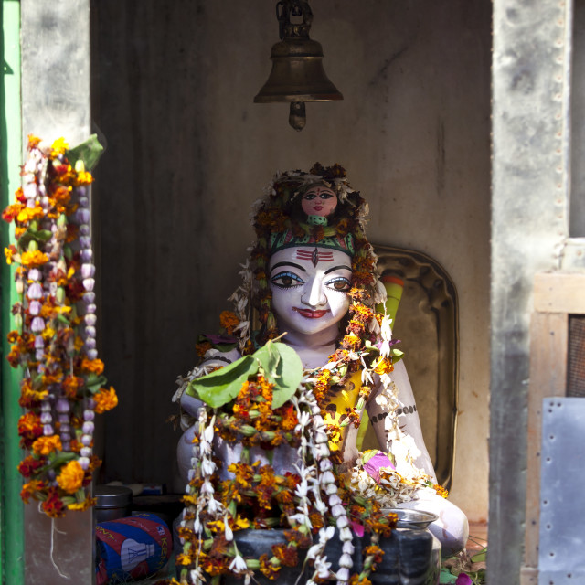 """Religious icon on display during Festival of Shivaratri in temple window in..."" stock image"