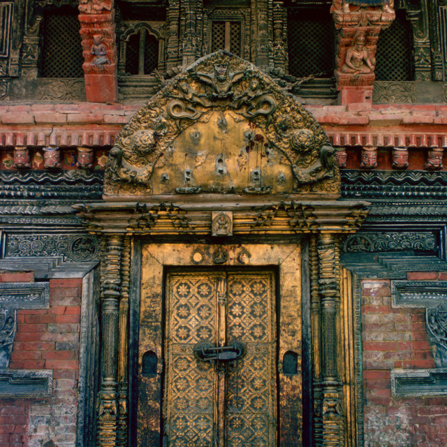 """""""An ornate carved and decorated doorway of a building in Patan - a city famous..."""" stock image"""