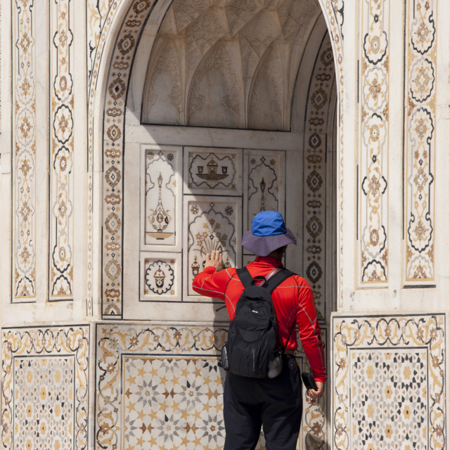 """Tourist at Tomb of Etimad Ud Doulah, 17th Century Mughal tomb built 1628,..."" stock image"
