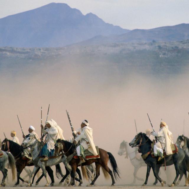 """Moroccan horsemen riding in an equestrian Fantasia in Morocco."" stock image"