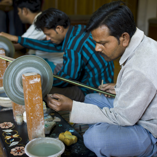 """Skilled craftsmen at work making Pietra Dura souvenirs using traditional..."" stock image"