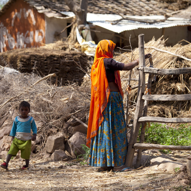 """Indian woman villager and child at her smallholding farm at Kutalpura Village..."" stock image"