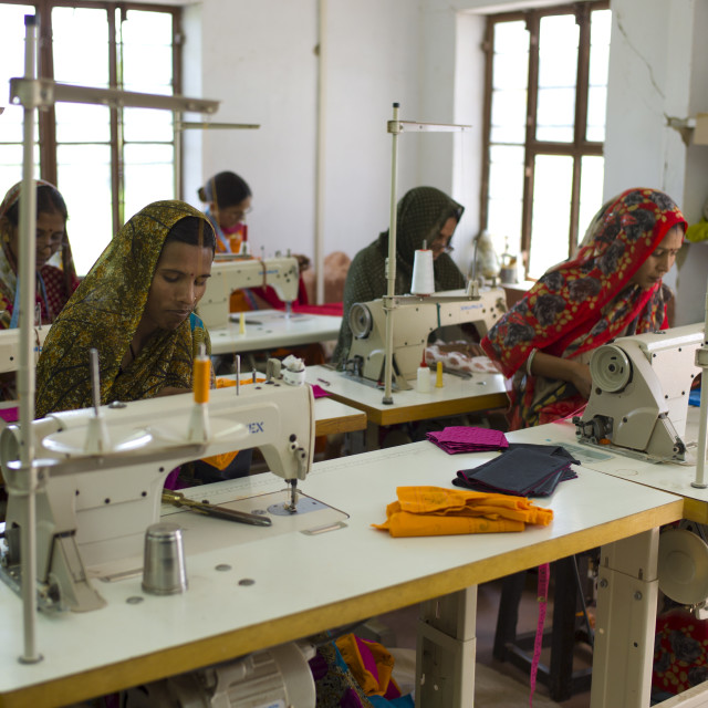 """Indian women sewing textiles at Dastkar women's craft co-operative, the..."" stock image"