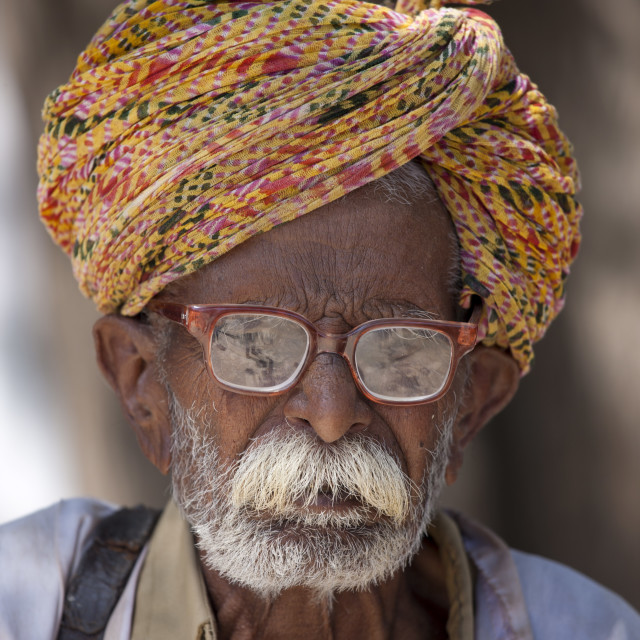 """""""Indian man, the local barber, in typical Rajasthani village of Nimaj,..."""" stock image"""