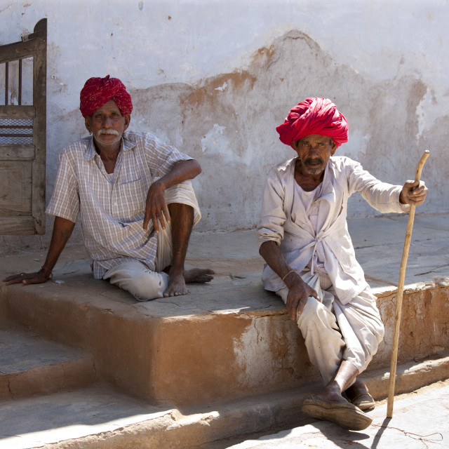 """""""Indian men wearing traditional clothing and Rajasthani turbans in village of..."""" stock image"""