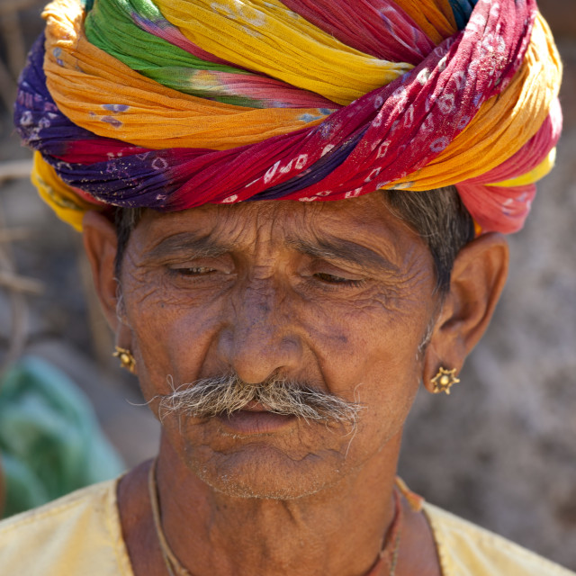 """""""Indian man wearing traditional Rajasthani turban and gold earring in village..."""" stock image"""