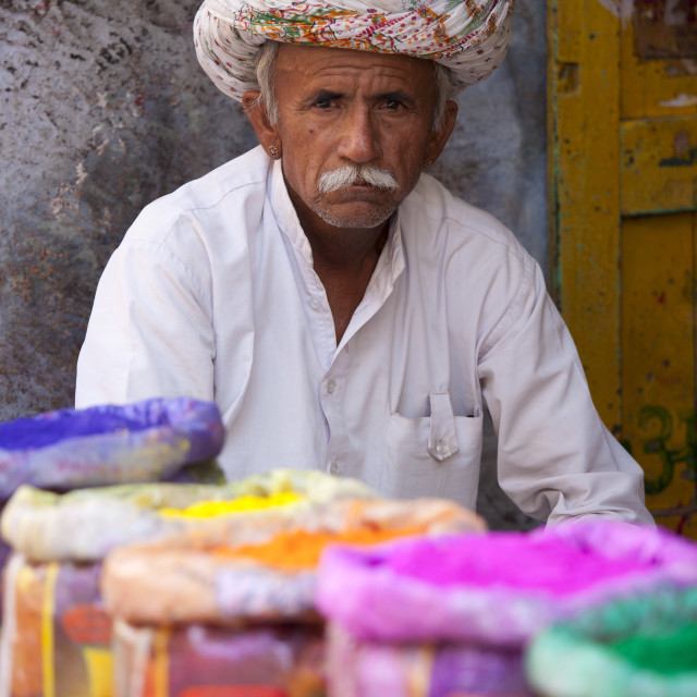 """Indian man selling powder paint colours for Holi festival on sale at Katala..."" stock image"