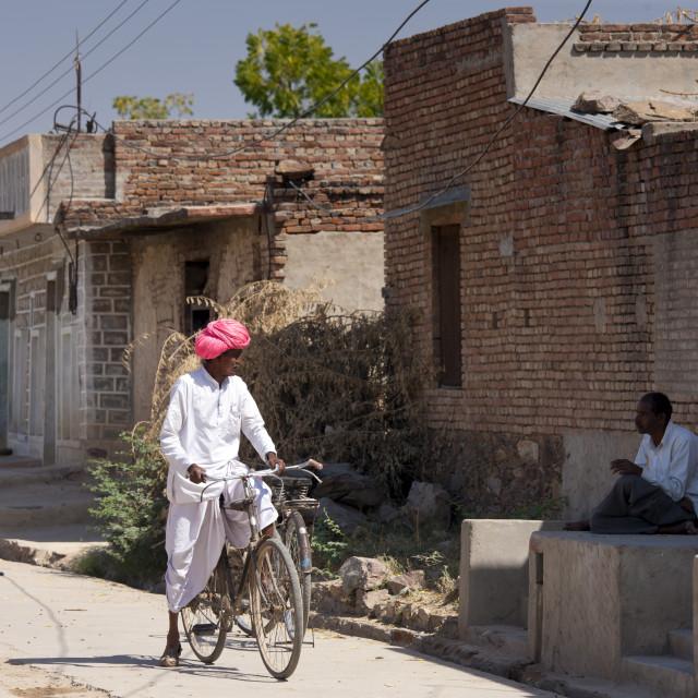 """Indian men chatting at Jawali village in Rajasthan, Northern India"" stock image"