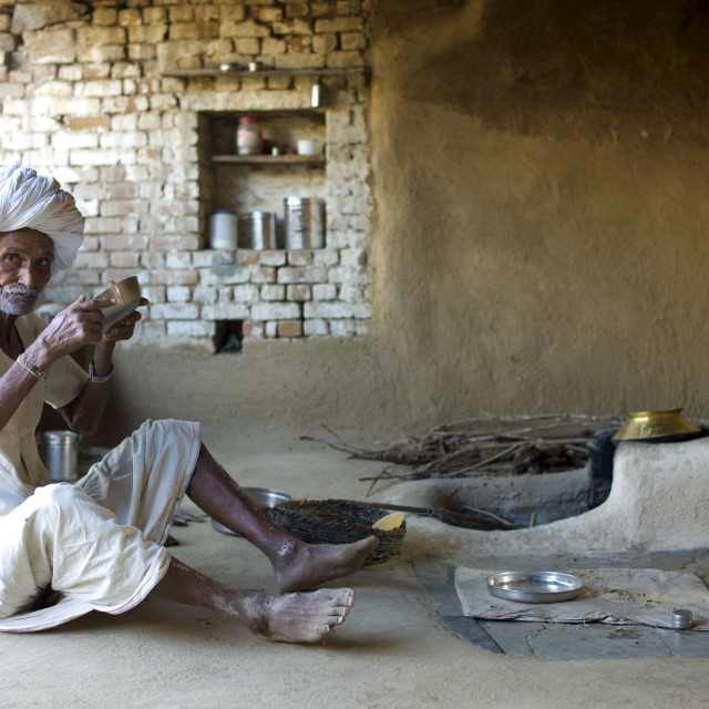 """""""Indian man drinking buttermilk at home in Narlai village in Rajasthan,..."""" stock image"""